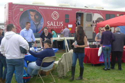 Health fair supporters and universities bringing help to the backstretch.